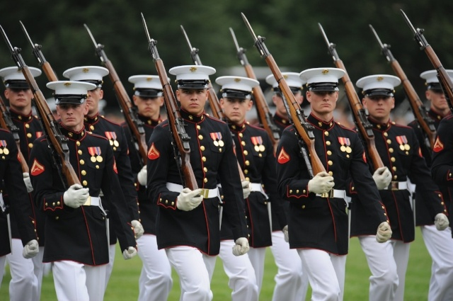 Defense.gov_News_Photo_100615-M-1549W-221_-_U.S._Marines_from_Marine_Barracks_Washington_march_by_during_the_pass_and_review_portion_of_the_Sunset_Parade_at_the_Marine_Corps_War_Memorial_in-507326-edited